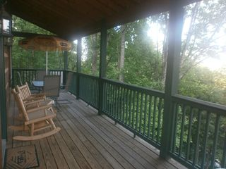 Boone cabin photo - Main level deck with seating for four & a stainless steel gas grill not pictured