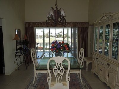 Lovely Dining Room with Sliders to Lanai and Water View