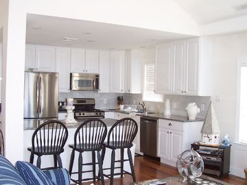 Kitchen with Island seating for 3