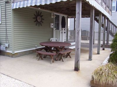 COVERED PORCH FOR OUTSIDE DINNING. ENJOY THE SHADE AFTER A LONG DAY AT THE BEACH