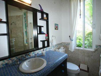 Akumal condo rental - Master Bath is outfitted with local marbles, sea glass and mohagony.