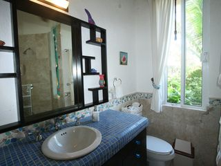 Akumal condo photo - Master Bath is outfitted with local marbles, sea glass and mohagony.