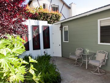 Private backyard with garden and bistro table...soak up the morning sun!