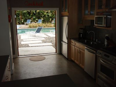 Even the kitchen opens to the pool.