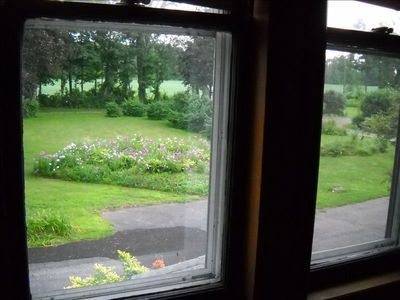 View of a garden from the East Lake Room.