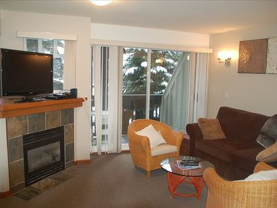 Family room with gas fireplace and new flatscreen TV w/cable