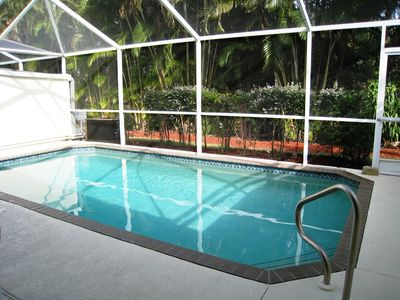 Private Heated Pool Area. Table seats four, chaise lounges and extra seating.