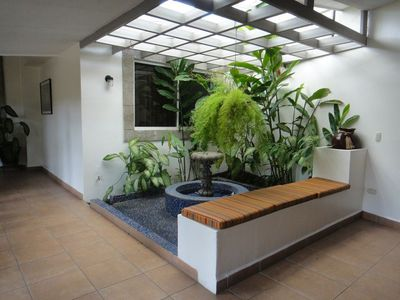 Cooling water fountains and tropical greens dress our courtyards..