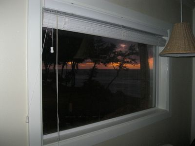 Kapaa condo rental - Sunrise looking through side window. Advantage of being on the corner!!