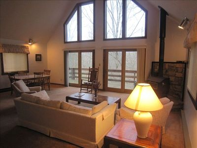 Great room overlooking 2nd deck's winter view of mountain and Lake Laura