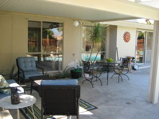 Rancho Mirage house photo - Backyard with seating area and cafe table for two.