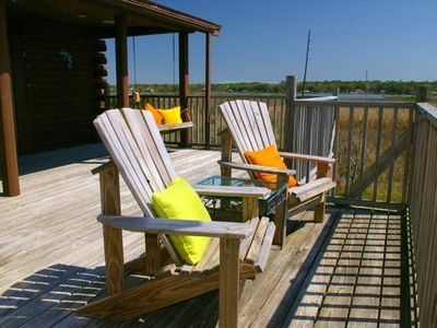 surround bay views from very large deck with lounge chairs dining table an swing
