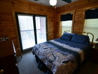 Sevierville cabin photo - This bedroom opens right to the patio and hot tub.