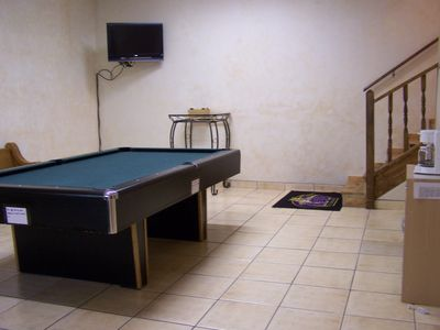 "Game Room in Basement with 32"" flat screen TV"