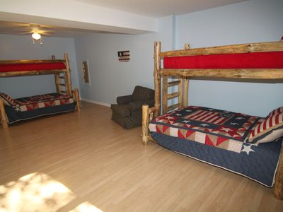 The huge bunkroom has two full beds and two twin beds