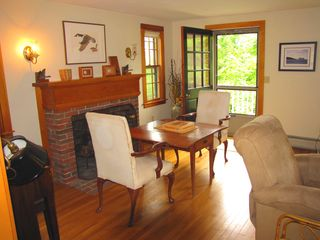 Vineyard Haven house photo - Living room with fireplace and door to deck