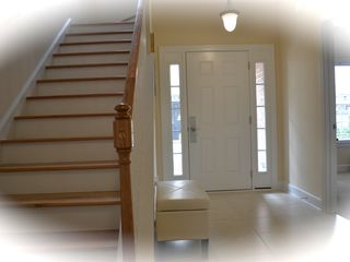Private Homes house photo - Inviting foyer with high quality white flooring with beach style