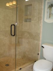 Emerald Shores house photo - 3rd Floor Bathro0m - Travertine walk-in shower (1 of 3)