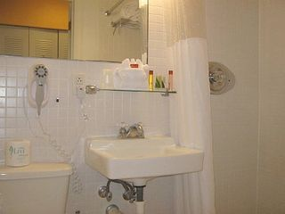 South Beach studio photo - Bathroom - toilet/shower/blow dryer, initial supply of towels and beach towels.