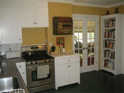 The kitchen is perfect for entertaining w/lots of cookbooks!