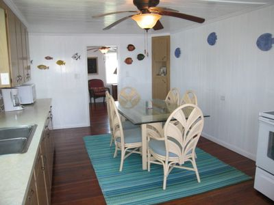 Fully-equipped eat-in kitchen w/paddle fan& new appliances.