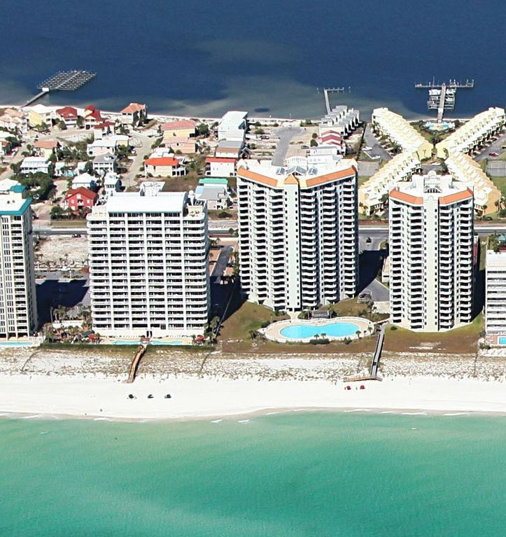 Navarre Beach condo rental - Beach Colony West is the center bldg. behind the Olympic size swimming pool