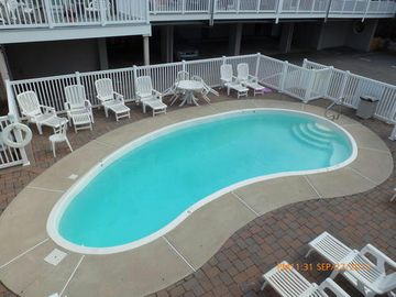 Heated pool with chaises, tables and chairs