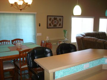 Buckeye house rental - Portion of breakfast bar, dining table and couch