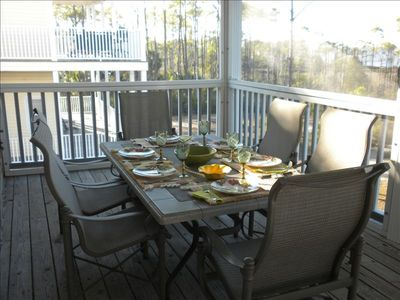 You can comfortably dine on a screened porch facing the Bay.