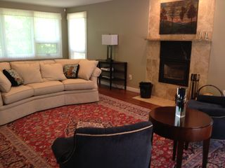 Bedford house photo - Living room with fireplace; opens to huge mahogany outdoor living space