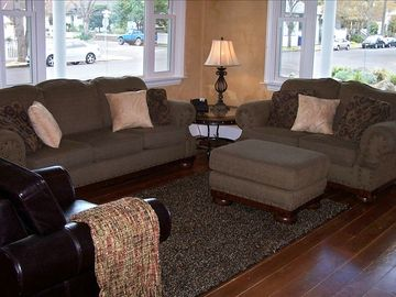 The spacious living room features comfortable seating