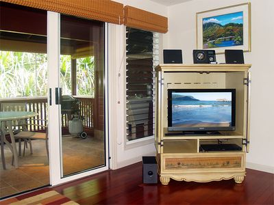 Riverhouse: Entertainment center with enclosed lanai that overlooks the river.