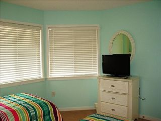 Kingston Plantation condo photo - Guest bedroom complete with high-def, flat-screen TV and conjoining bath!