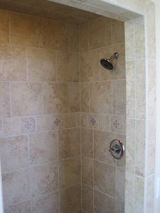 Walk in shower and bench in both master bedrooms