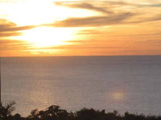 Aguadilla apartment photo - Spectacular sunsets from unit balcony!