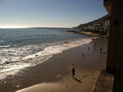 Malibu house rental - People walking on beach below house