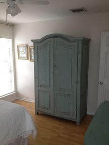 BR2 armoire with 24' flat screen TV inside