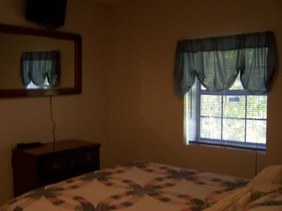 Queen Bed in Basement area with flat screen TV