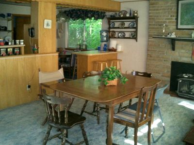 Dining to kitchen with breakfast nook.