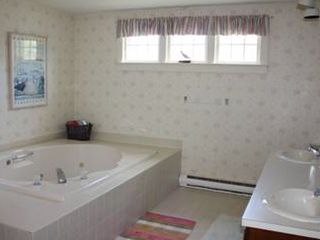 Cisco Beach cottage photo - Master Bath- Double sinks, shower, jacuzzi and laundry.