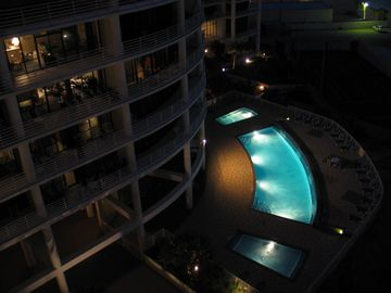 Our large heated pool and hot tub look inviting at night! Open until 11PM.