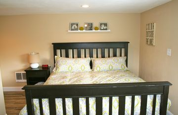 The king bed in the master bedroom.
