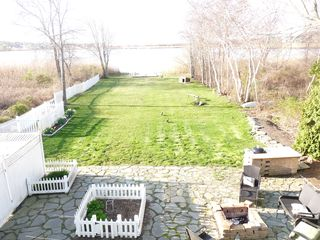 Bonnet Shores house photo - EXPANSIVE YARD, HERB GARDENS, OUTDOOR KITCHEN AND FIRE PIT.