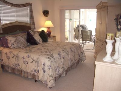 Master bedroom with access to lanai/pool, with cable TV, and walk-in closet