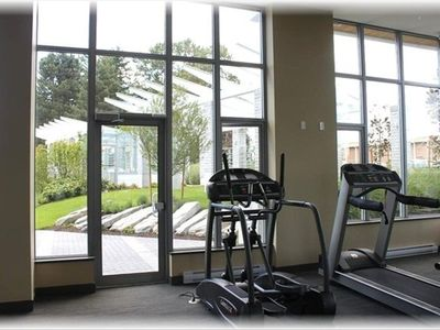 Gym with 3 treadmills, weight machine and free weights