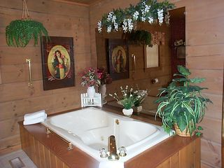 Two person jetted tub with mood lighting above - Pigeon Forge cabin vacation rental photo