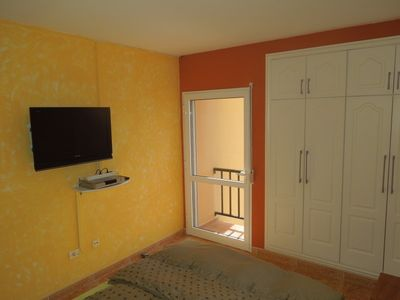 Flat screen TV and small balcony on the 2nd Bedroo
