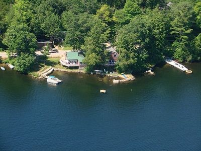 View from the air. Your house has the green roof. Note a tennant's boat at dock.
