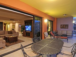 Puerto Penasco condo photo - Living room opens up to balcony which has a dining set and a cozy seating area