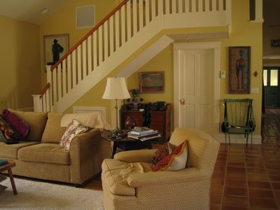 Living room (guest room straight ahead through door) and staircase to the loft.